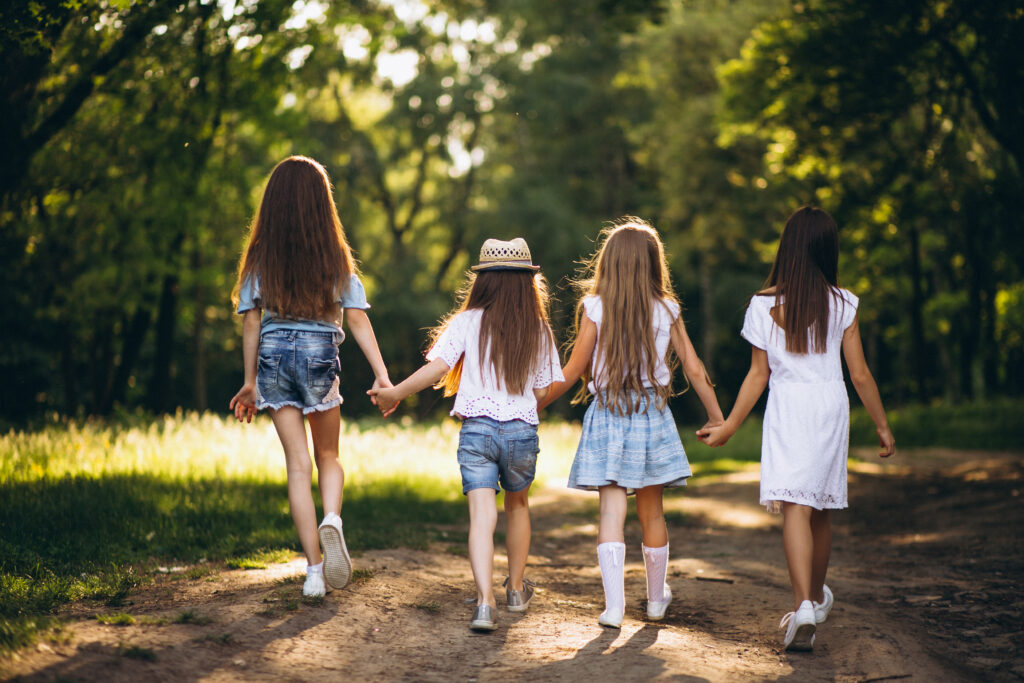group-of-teens-girls-having-fun-in-forest